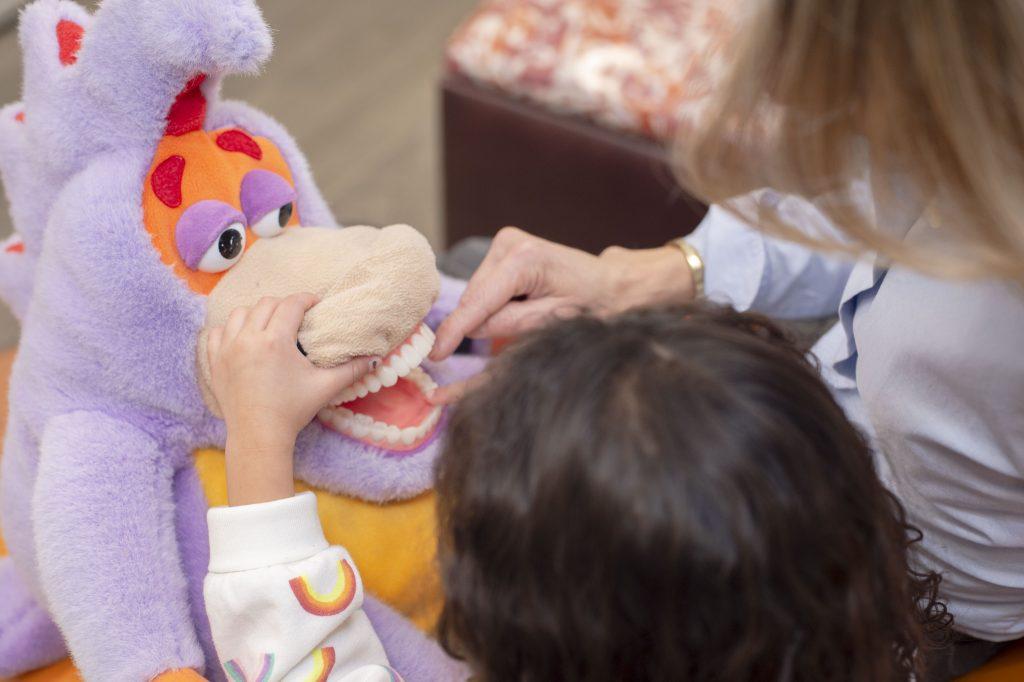 Dr. Corielli teaching child